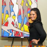 "Siana Treece standing in front of one of her paintings titled ""Moodswings""."