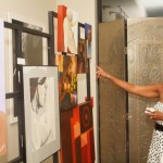 Guests admiring the artwork of Calvin Brazile, featured artist for the evening.