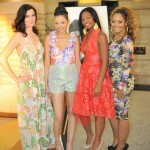 Siana Treece poses with her models wearing The Siana Treece Spring Collection.